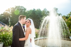 Bridal couple near fountain