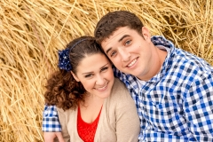 Engaged couple in hay